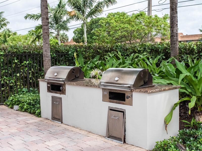 Photograph of grills near pool