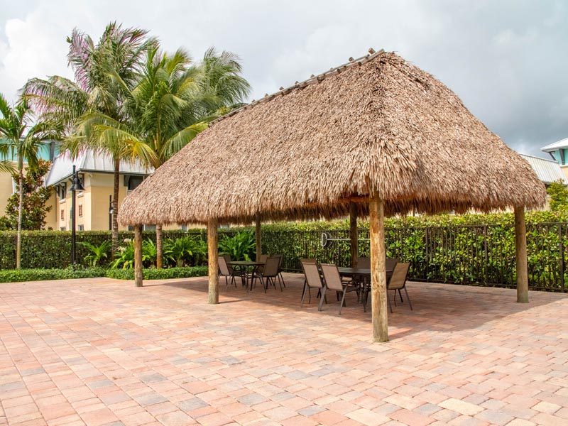Photography of tiki hut by pool